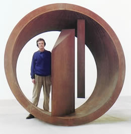 Nigel Hall with his sculpture: Within and Without, 1999 corten steel 245 x 250 x 135 cms.
